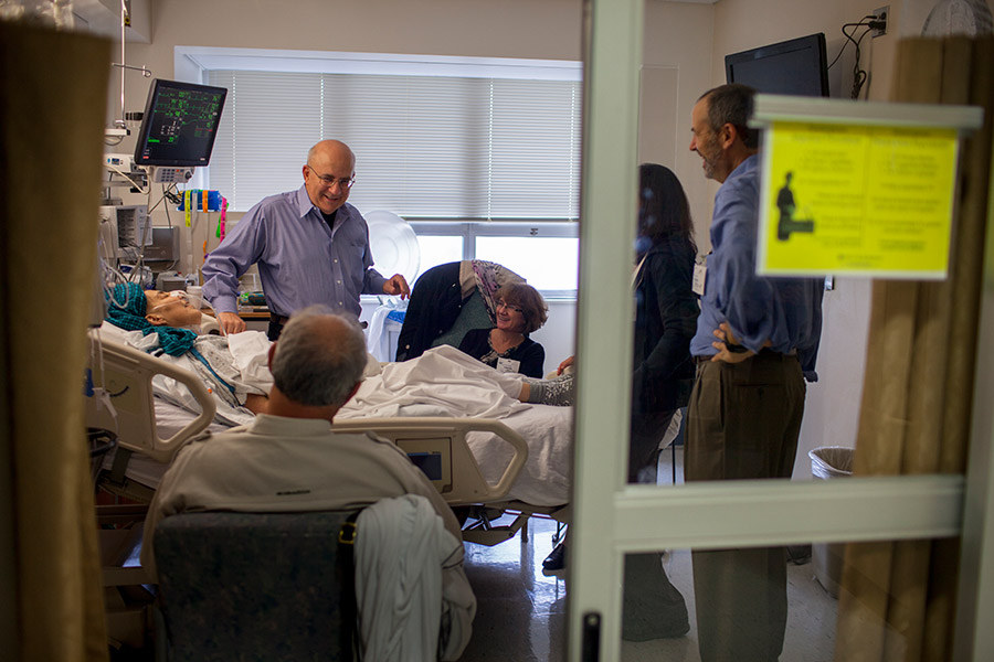 Ed holds court, livening things up in the hospital room.