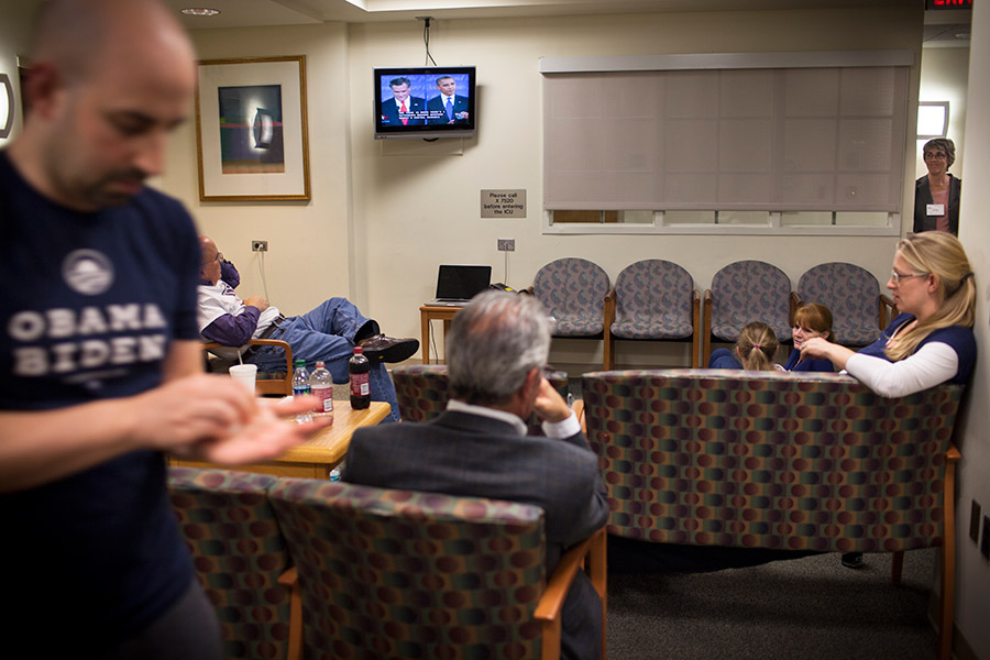 Family gathers to watch the first of three presidential debates between Barack Obama and Mitt Romney in the hospital waiting room.