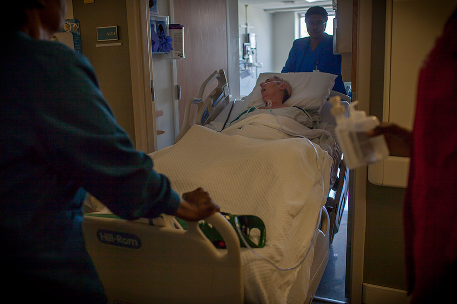 Debbie is wheeled into a hospice room at the hospital.