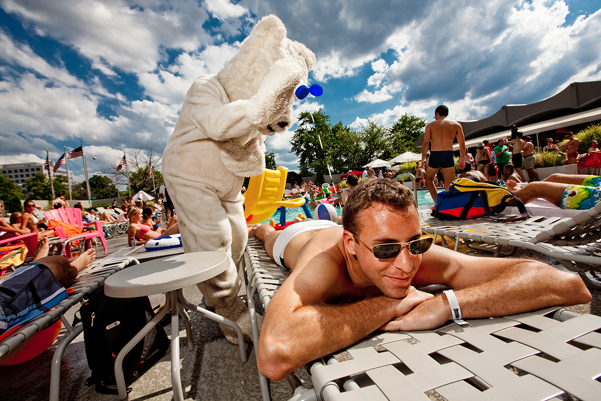 A polar bear applies sunscreen to a sunbather at the Capital Skyline Hotel in Washington, D.C.